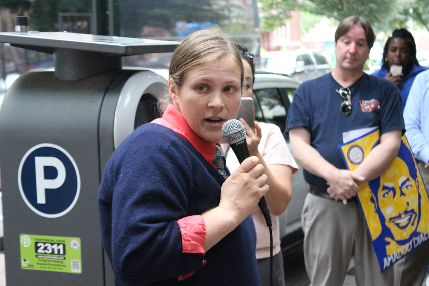 Amanda Kirchgessner speaks to a crowd in front of the Office for Human Rights during last year's budget season.
