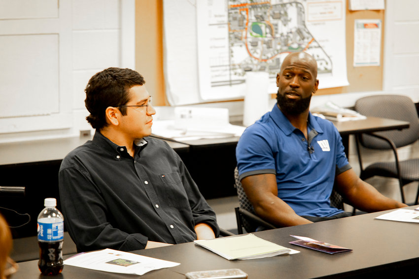 Giants player Michael Thomas, right, and College Initiative Upstate participant Ricardo Escobedo talk about the local success of alternatives to incarceration.