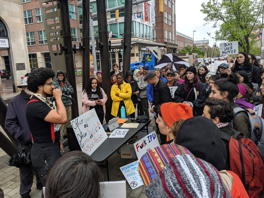 Rafael Aponte addresses the crowd gathered at the Bernie Milton Pavilion on May 13 for a rally organized by Black Lives Matter - Ithaca.