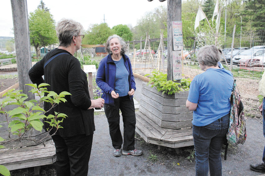 Harriet Becker leads a tour of the Ithaca Children's Garden at a recent celebration of the garden's 20th anniversary. The garden started as a project to get more kids and teens into gardening and landscaping.