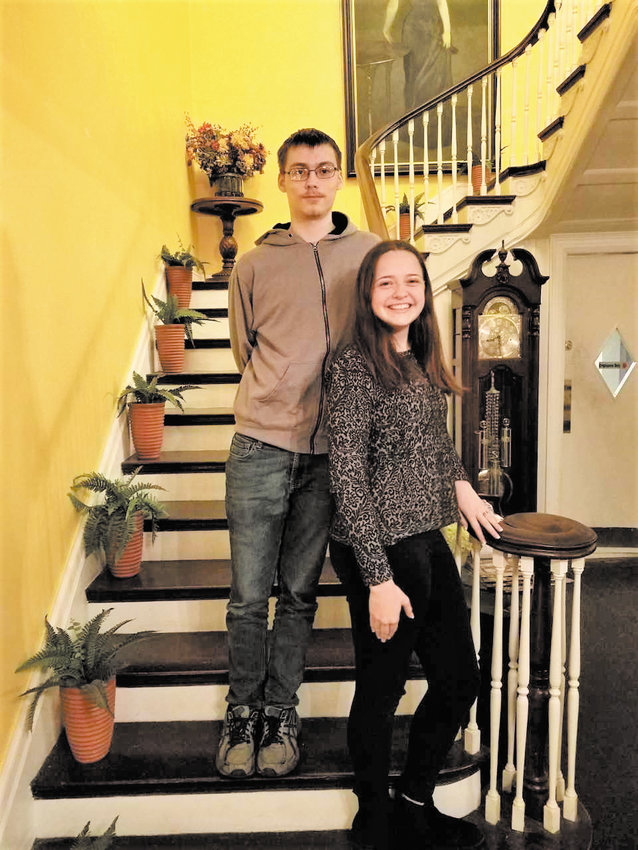 Diaz Niño (left) and Madeline (Maddie) Stamm, posed on the staircase of the Benn Conger Inn. The students were honored at a celebratory dinner Wednesday, May 15, as they will both graduate from TC3 the same year they graduate from Groton High School.