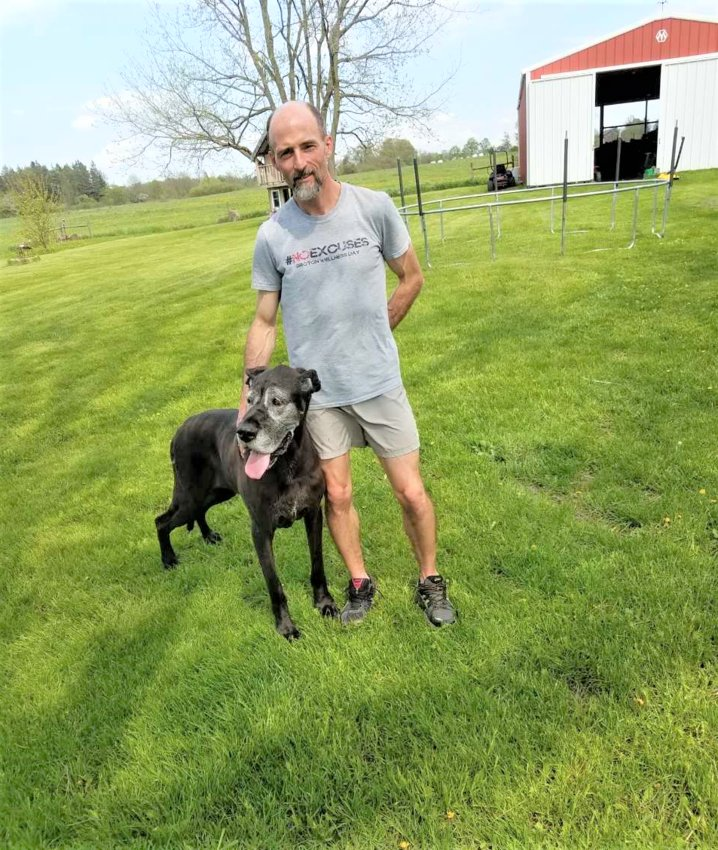Groton Jr./Sr. High School health teacher and track and cross-country coach, Scott Weeks, and his nine-year-old Great Dane, Simpy.