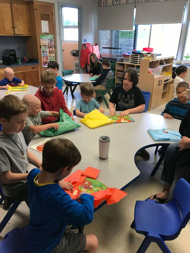 Stacy Tilton's third grade class helped purchase and gift wrap books to give to Lindsey Snyder's pre-k class in the Trumansburg school district as part of the Chidlren's Reading Connection innitiative.