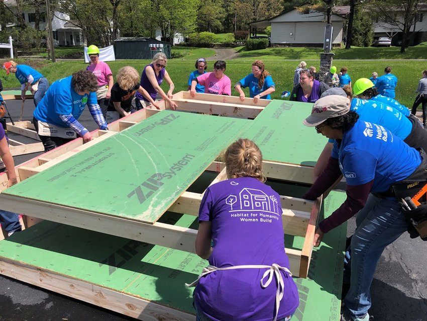 The Women Build events bring women from all backgrounds and skill levels to help build a house for Habitat for Humanity.