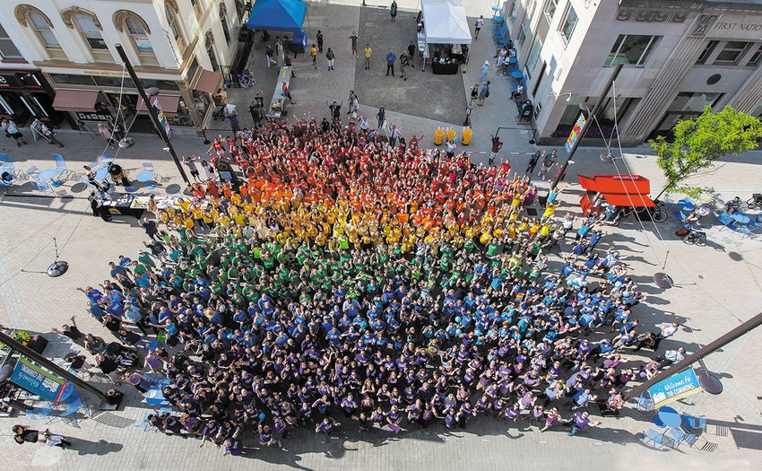 After the shooting at a gay nightclub in Orlando on June 12, 2016, the community was invited to come together to show support for the LGBTQA community by creating this photo. Members of the community say they generally feel safe, but see room for improvement on LGBTQA issues locally.