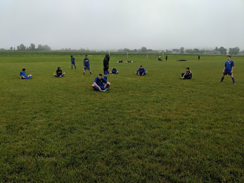 The Lansing United U19 team goes through warmups ahead of a spring league game.
