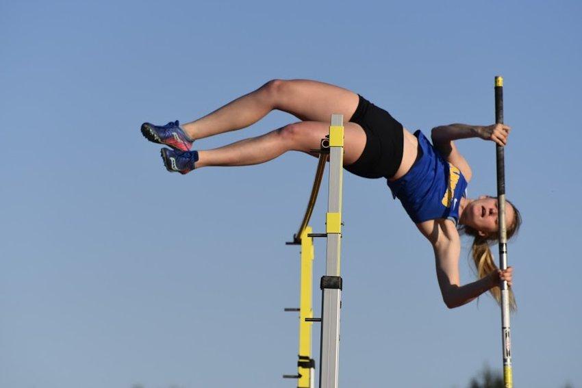 Lansing's Gwen Gisler vaults at the IAC Championship meet at Marathon on May 6.