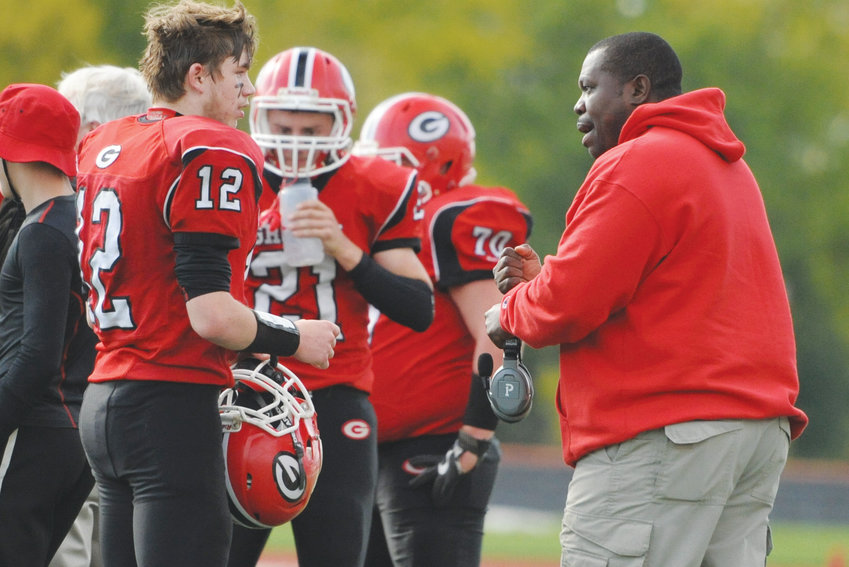 Eric Prior, 51 (right), was head coach of the Groton Indians football and basketball teams. He died unexpectedly last week.
