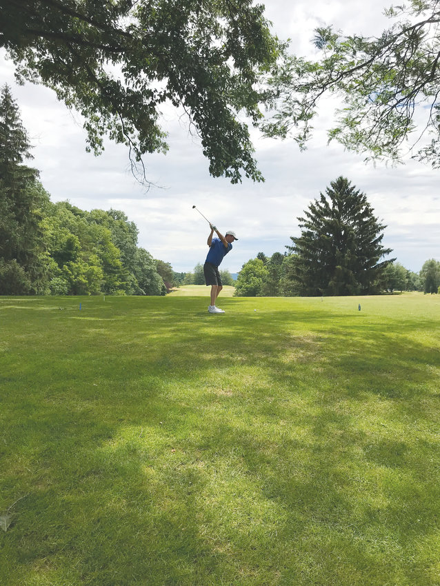 John Duthie (above), a graduate of Lansing High School, tees off on the first hole during the Ithaca Best Ball Tournament. Duthie has won the tournament twice - once in 2008 and again in 2013.