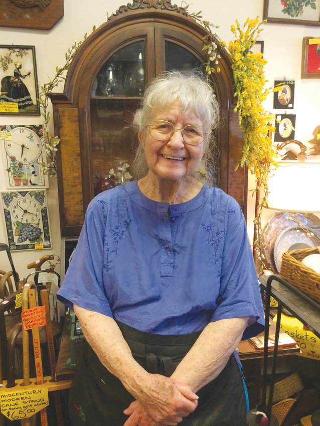 Laurel Hessler (above) has come a long way from her home state of Iowa to Ithaca, where she works with her daughter at East Hill Antiques.
