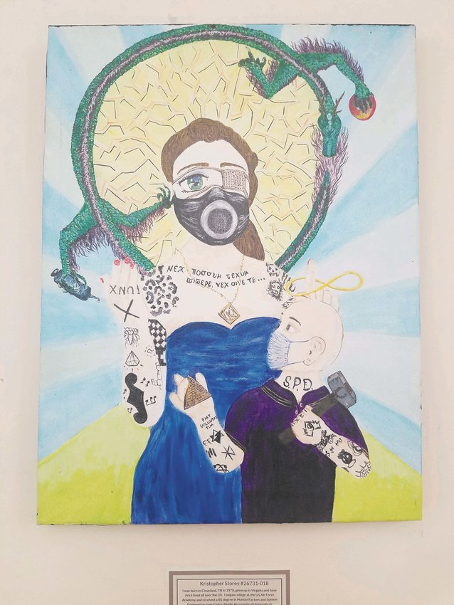 Kristopher Story's artwork (above) is one of the many pieces of artwork by prisoners currently on exhibit at the Ulysses Philomathic Library.