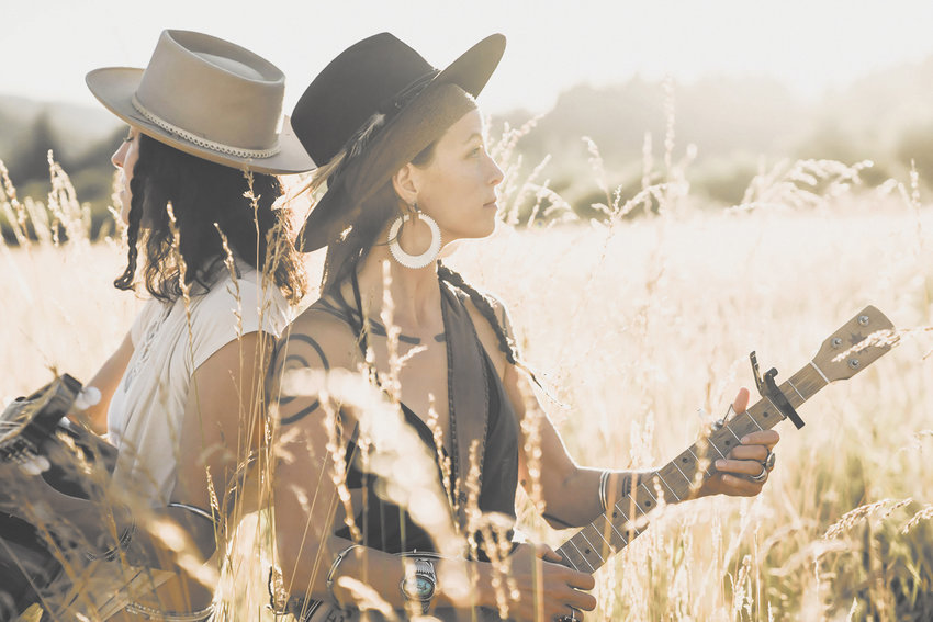 Rising Appalachia's Chloe (left) and Leah (right) Smith have been in the music business for over a decade and are excited to bring their genre-bending music to the audiences at the Finger Lakes GrassRoots Festival of Music and Dance July 18.