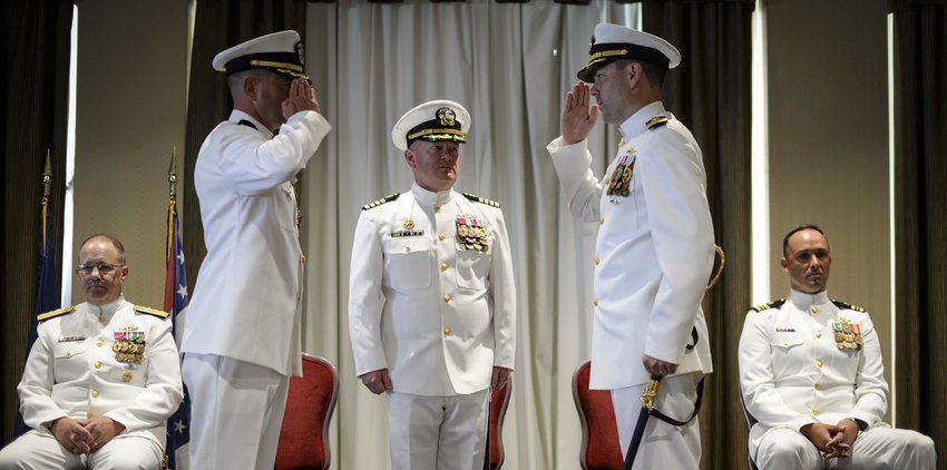 190726-N-KW679-1106 NORFOLK, Va. (July 26, 2019) Cmdr. Benjamin Pollock, right, relieves Cmdr. John Strunk, left, as commanding officer of USS Wyoming at a change of command ceremony in Norfolk, Virginia, July 26, 2019. Wyoming is an Ohio-class ballistic missile submarine, weighing nearly 2,100 tons and manned by a crew of 153 Sailors. (U.S. Navy photo by Mass Communication Specialist 3rd Class Kristen Cheyenne Yarber)