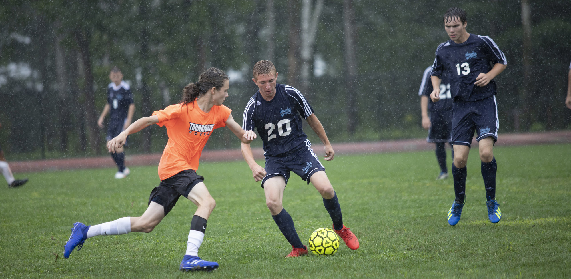 Trumansburg's Elijah Schechter (left, foreground) charges the ball agianst Moravia at Bond Fest on Aug. 28.