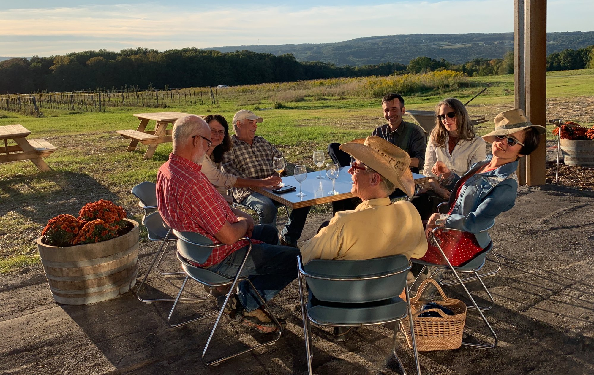From red shirt clockwise around the table: Toby Dean, Elizabeth Teskey, David Jones, Matt Cooper, Minnie Jardine,