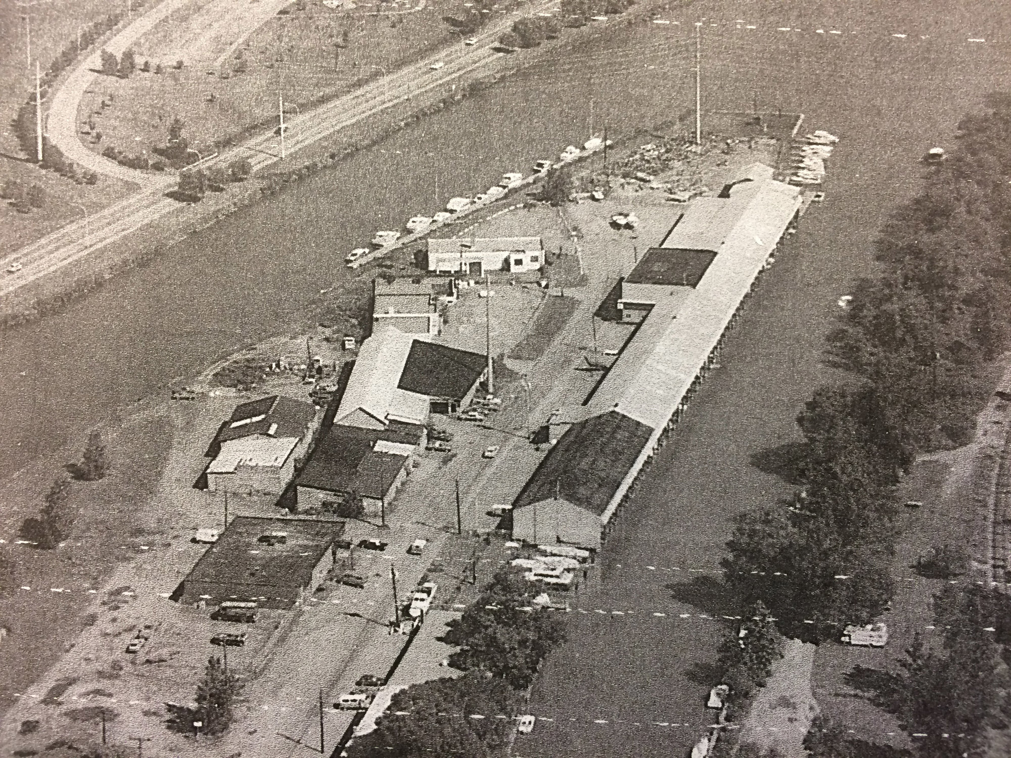 Inlet Island in the 1970s. The place that would eventually house places like Island Health and Fitness and the Boatyard Grill was once home to industrial businesses, creating a very different atmosphere and culture around the waterfront.