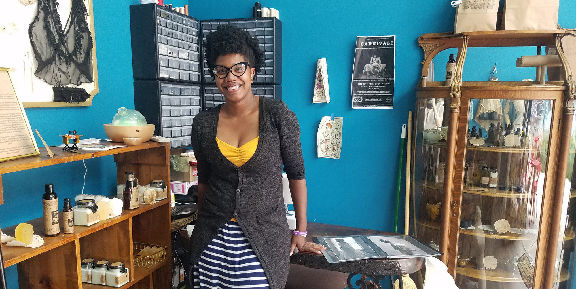 Adrina Dietra stands in her shop in Press Bay Alley. Dietra opened her business on June 27, bringing her luxury lingerie and homemade apothecary goods to downtown Ithaca. She said she loves providing products that attract a wide audience.