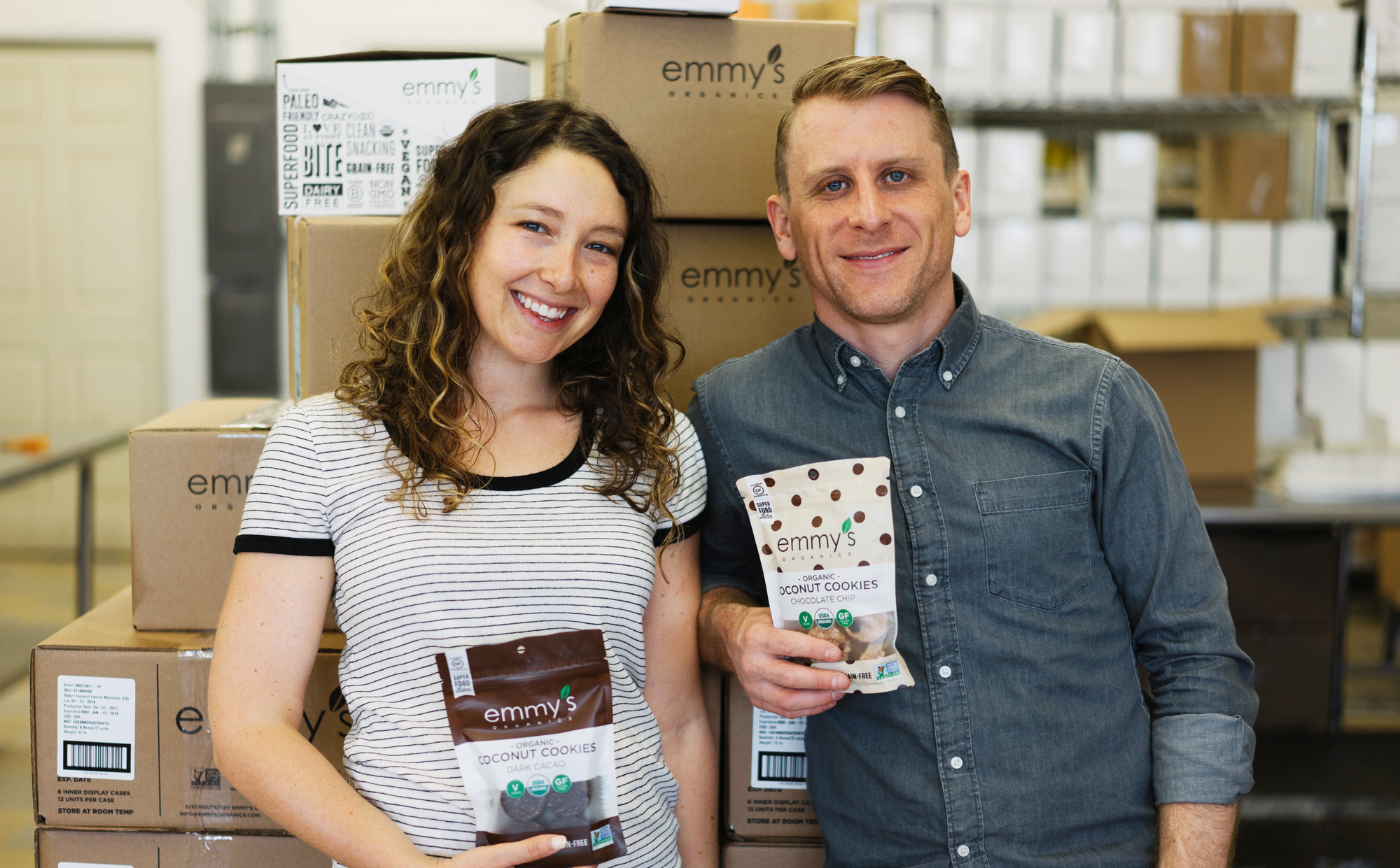 Emmy's Organics creators Samantha Abrams (left) and Ian Gaffney (right) with their signature organic, gluten-free, non-GMO coconut cookies. The two started the company after creating a cookie Gaffney could enjoy with his dietary restrictions.