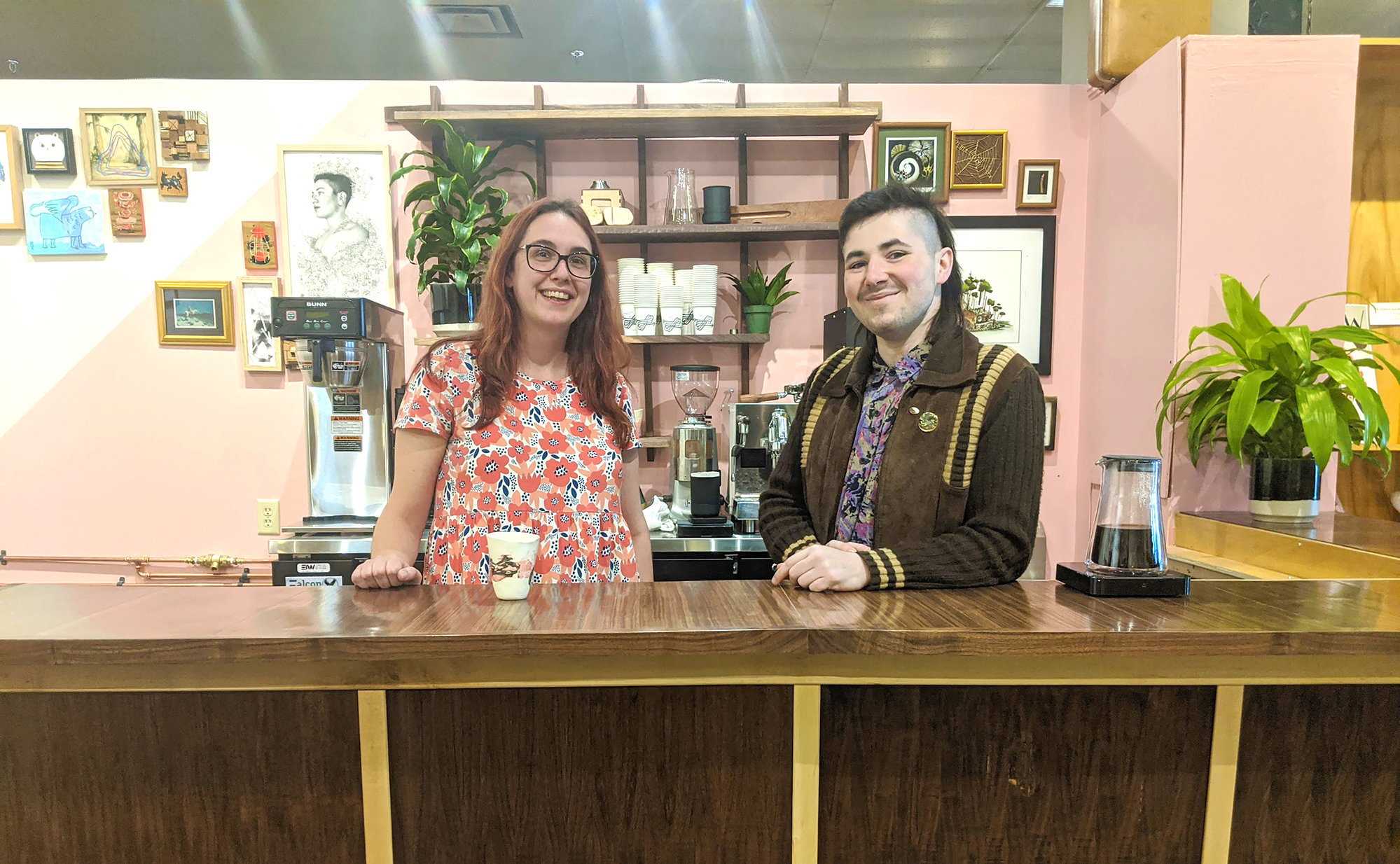 Megan Vidler (left) and Caleb Harrington (right) stand behind the bar of Nothing Nowhere Café, located inside of Home Green Home on the Ithaca Commons.