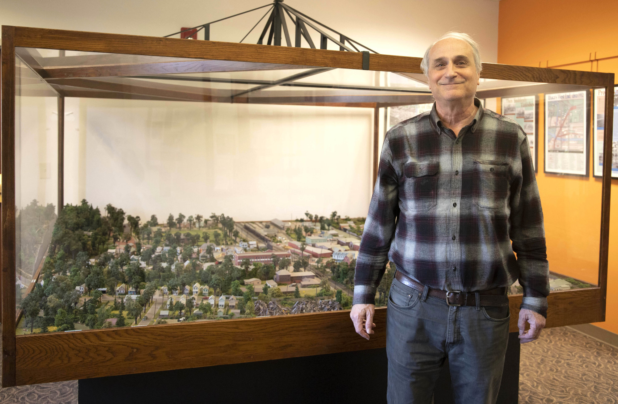 David Fogel stands in front of his scale model of Ithaca's West End circa 1960, currently located on the second floor of Alternatives Federal Credit Union. Due to renovations to Alternatives, Fogel is hoping to find a new place to display his project.