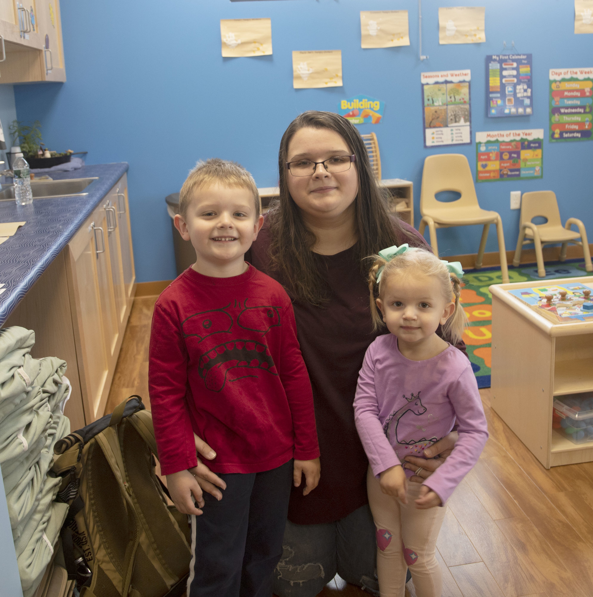 Heather Dries (center) stands with her two kids, Marshall (left) and Macie-Sue (right) at the TC3 Childcare Center.