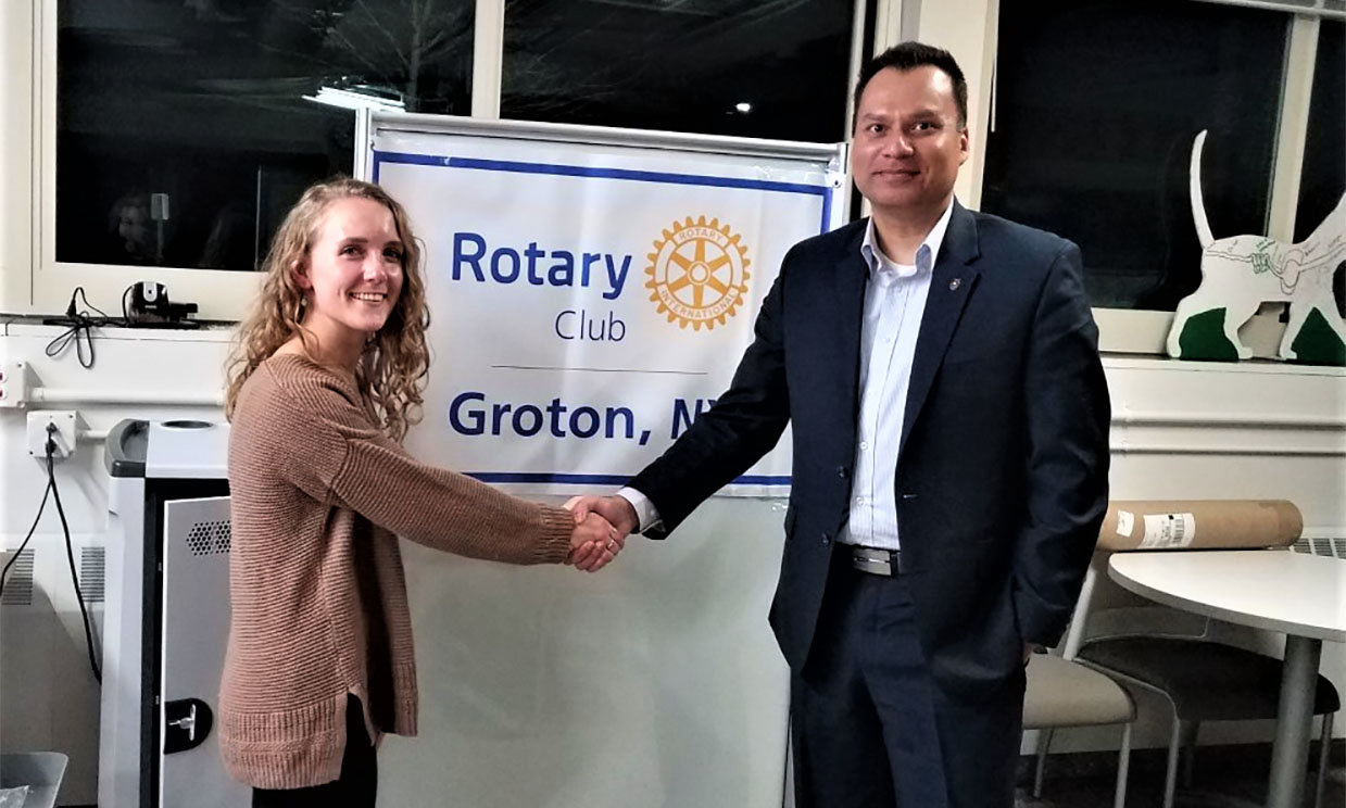 Moira McJury (left), education and prevention coordinator for the Alcohol and Drug Council of Tompkins County, and Nasar Khan (right), president of Groton Rotary Club, shaking hands following McJury's presentation on vaping and opioid drugs.
