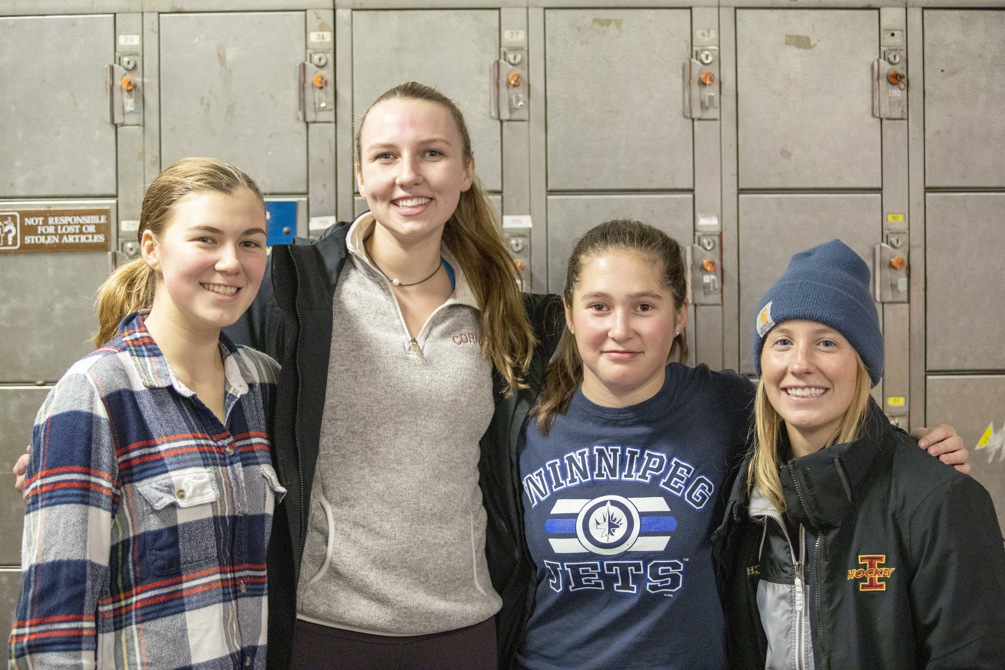 Ithaca girls hockey captains (from left to right) Leah Henseler, Nicole Nixon and Tess Crane and head coach Holly Norsen.