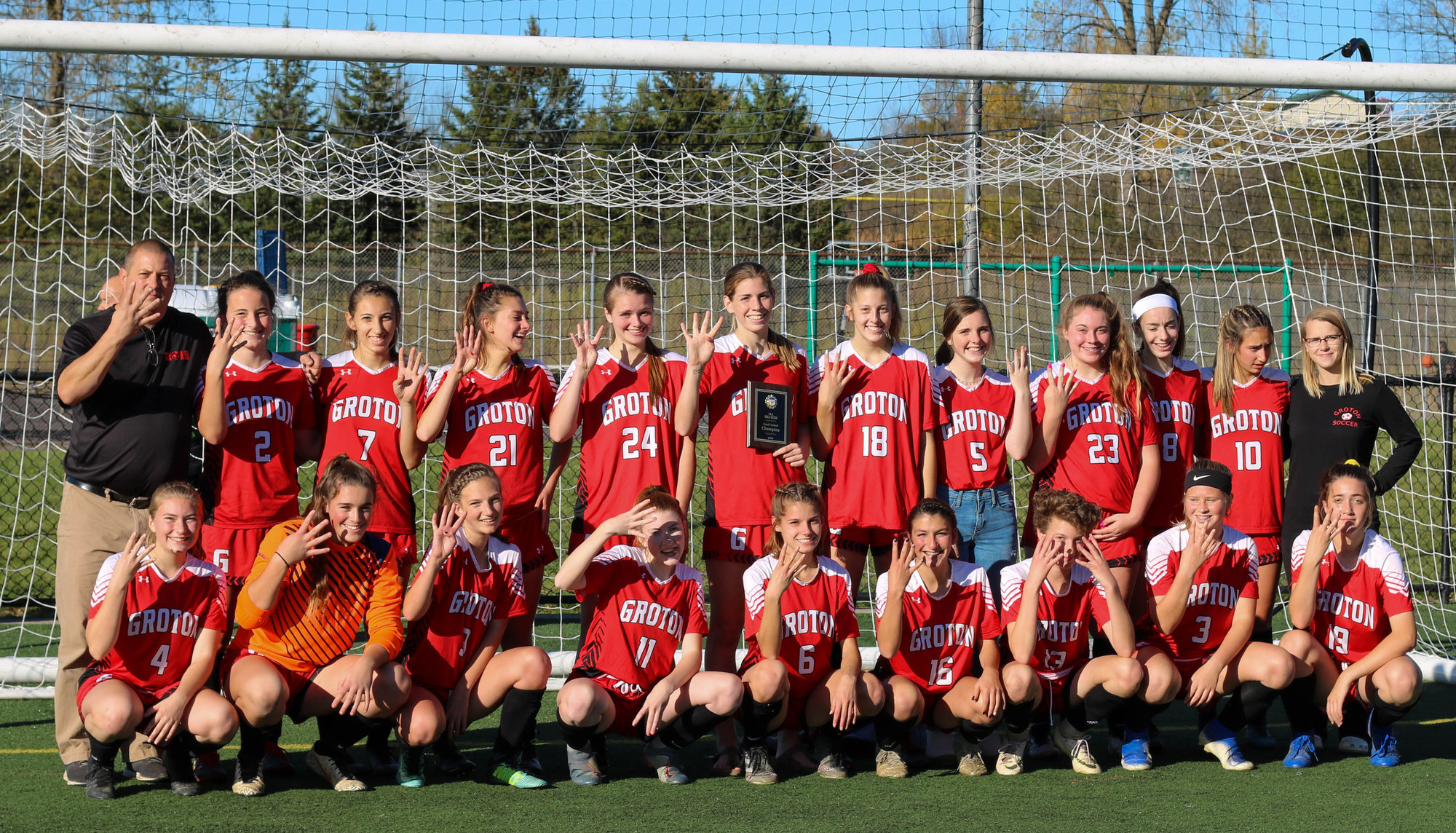The Groton girls soccer team celebrates its fourth consecutive IAC Championship victory.