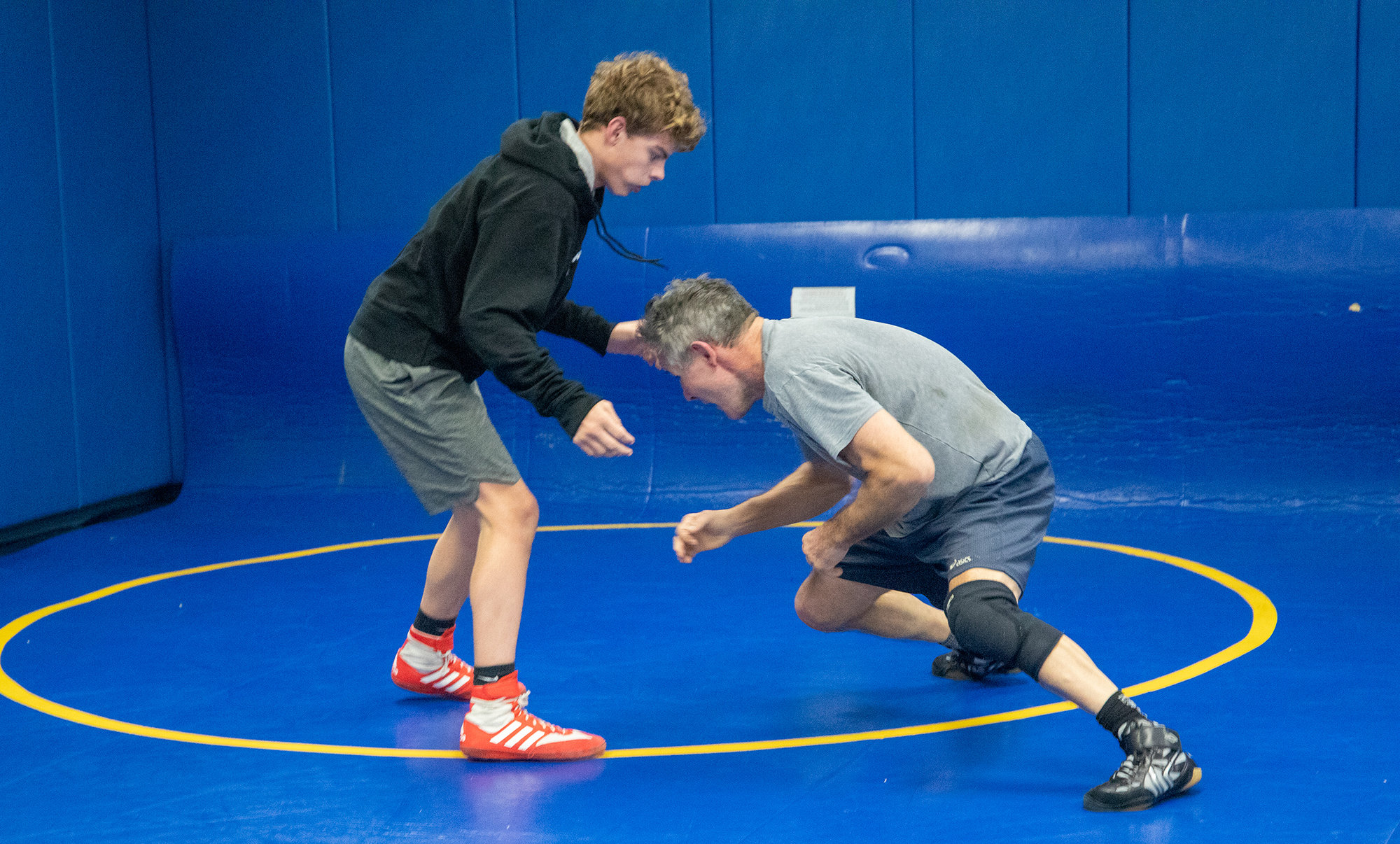 Owen Emmick (left) trains with Lansing wrestling head coach Gene Nighman (right). Nighman has coached at both Cornell and SUNY Cortland.