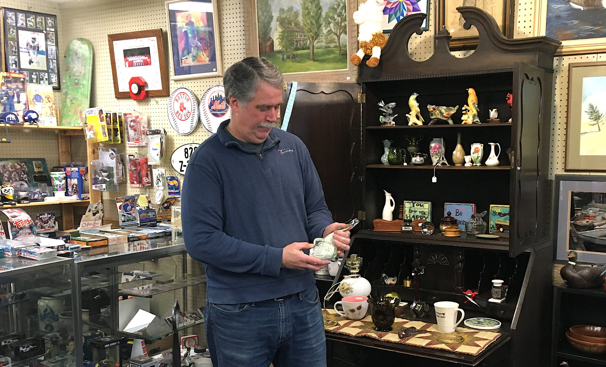 Jay Engles with a small portion of the widely varied stock of Lansing's The People's Market. Jay and his co-owner and spouse Carol started the shop 10 years ago to sell products from their alpaca farm. The market has grown to 40 local venders since.