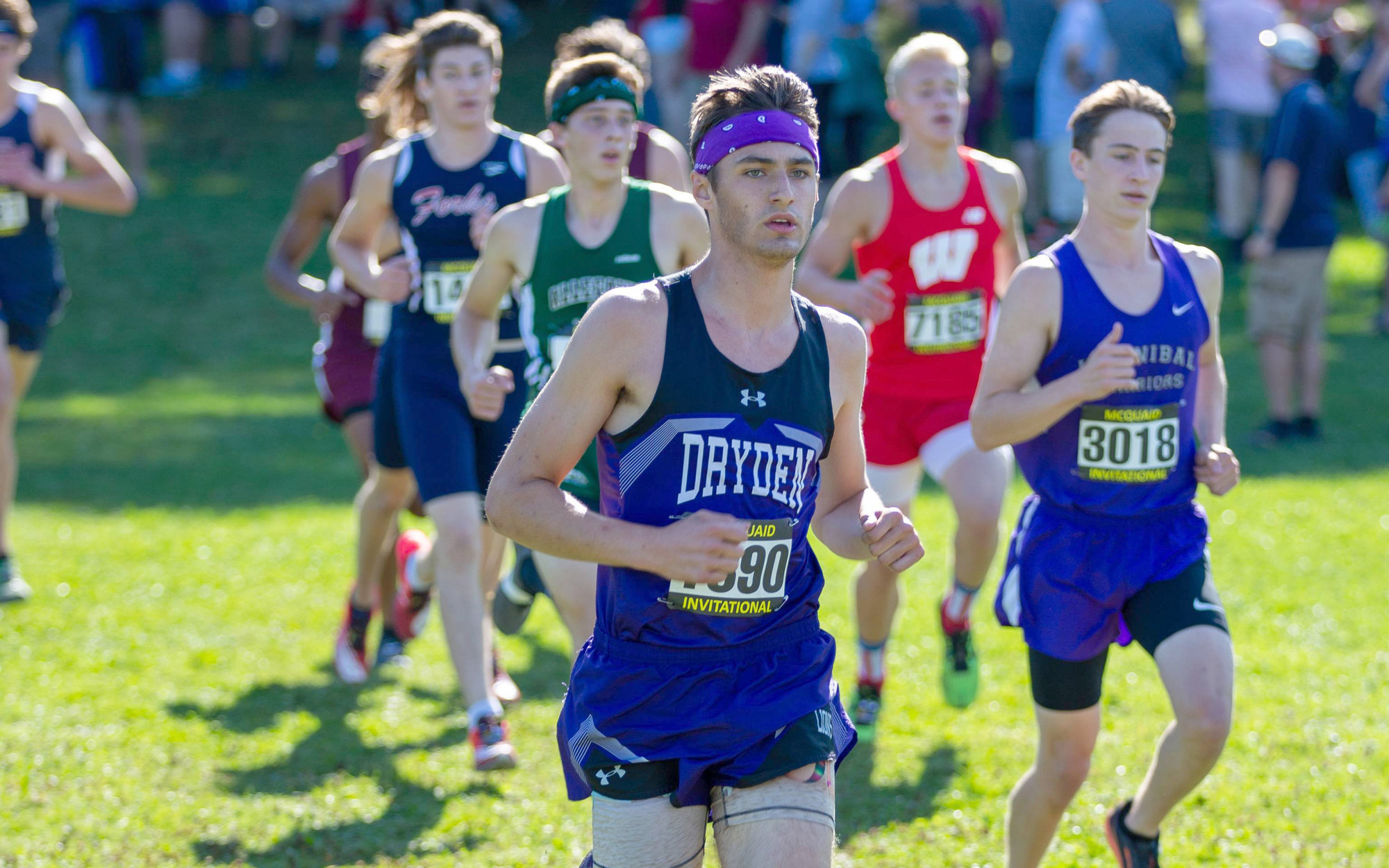 Jakob Greenwood (center) runs in the McQuaid Cross Country Invitational last season. He set Dryden's indoor 600m run record at the Section IV Classic on Jan. 4 at Cornell University with a time of 1:24.68, surpassing the previous 1:26.81.