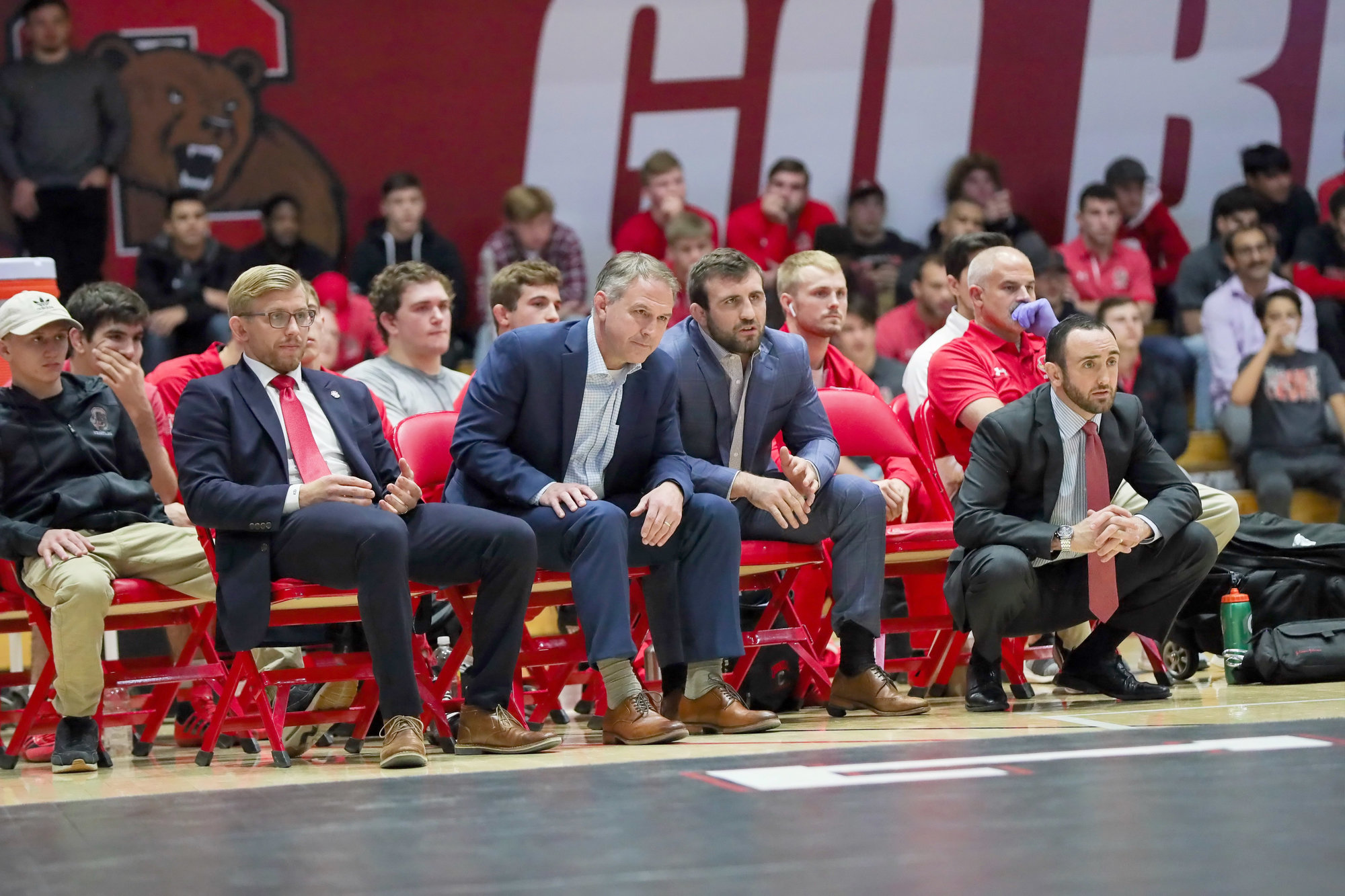 Cornell wrestling coaches (from left to right): Kyle Dake, Rob Koll, Gabe Dean and Mike Grey observe a match at home. Cornell qualified eight wrestlers for nationals this year, their most since 2016.