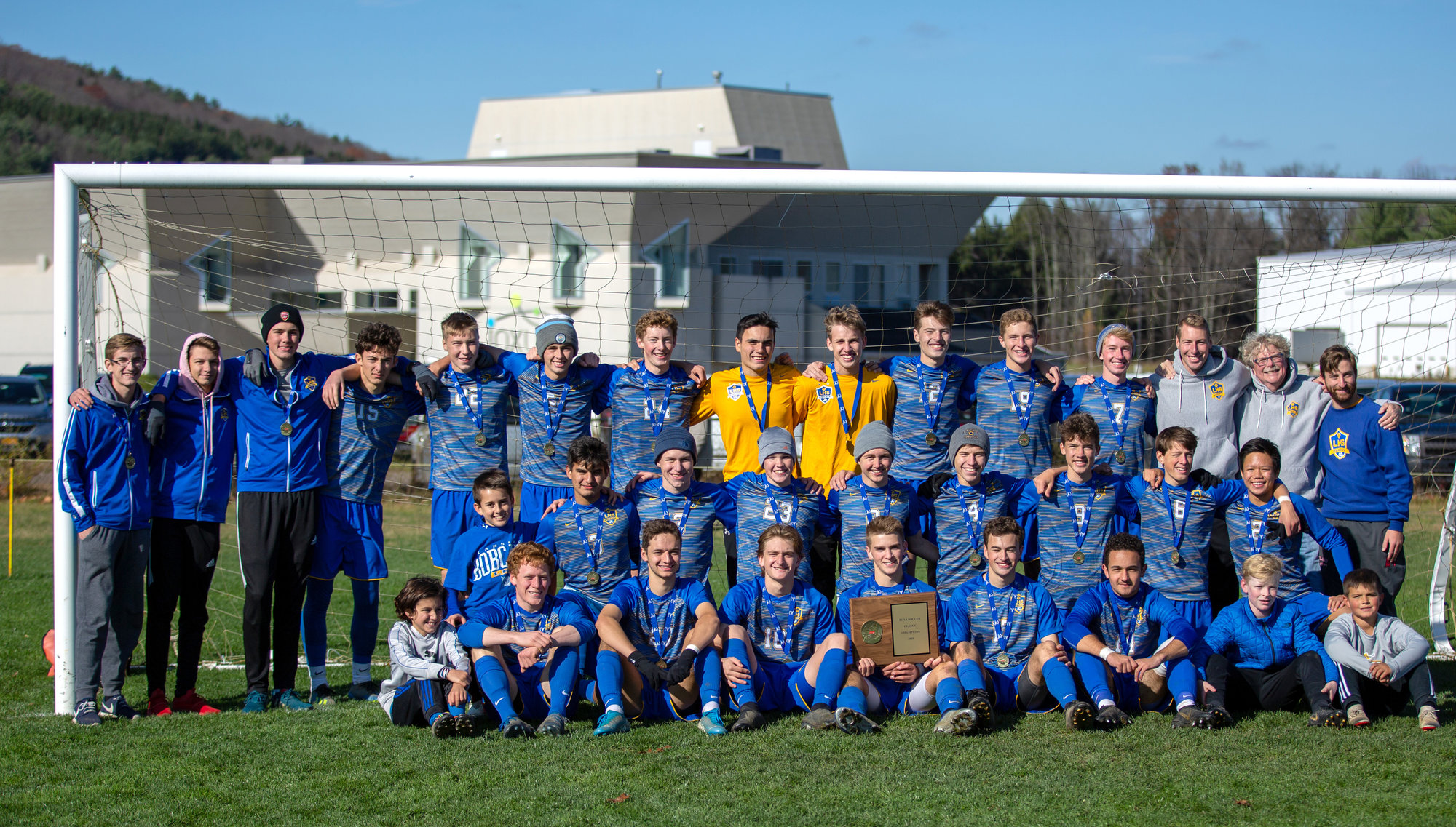 Lansing boys soccer celebrates its fourth consecutive Section IV title. The Bobcats were one of three Tompkins County boys teams to win sectional championships this year.