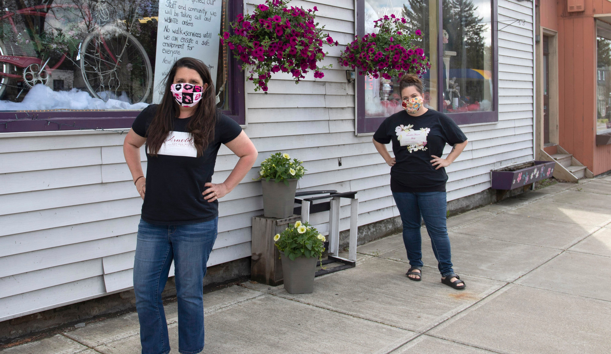 Owners Marcy Brandt (left) and Anastacia Mosher-Arnold stand outside their Dryden-based business, Arnold's Flowers. While the two have been able to operate since just before Easter, phase one of reopening has necessitated a clearer business plan.