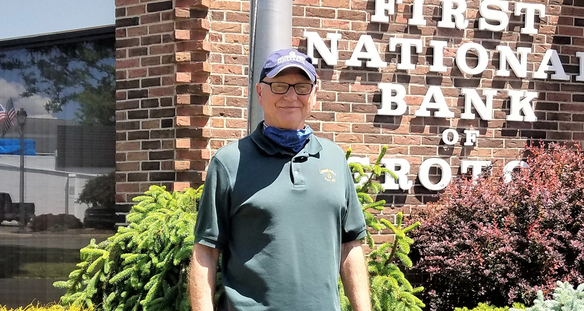 Alan Christopher, senior vice president of the First National Bank of Groton, stands in front of the bank he has worked at for the past 50 years.
