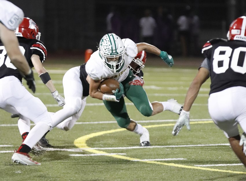 Horizon receiver Canaan Mullins fights through a tackle during the Huskies'  49-0 win over Paradise Valley.