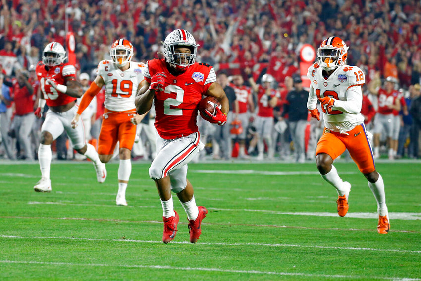 Ohio State running back J.K. Dobbins carries for a touchdown against Clemson during the first half of the Fiesta Bowl College Football Playoff semifinal Saturday at State Farm Stadium in Glendale. [AP Photo/Ross D. Franklin]