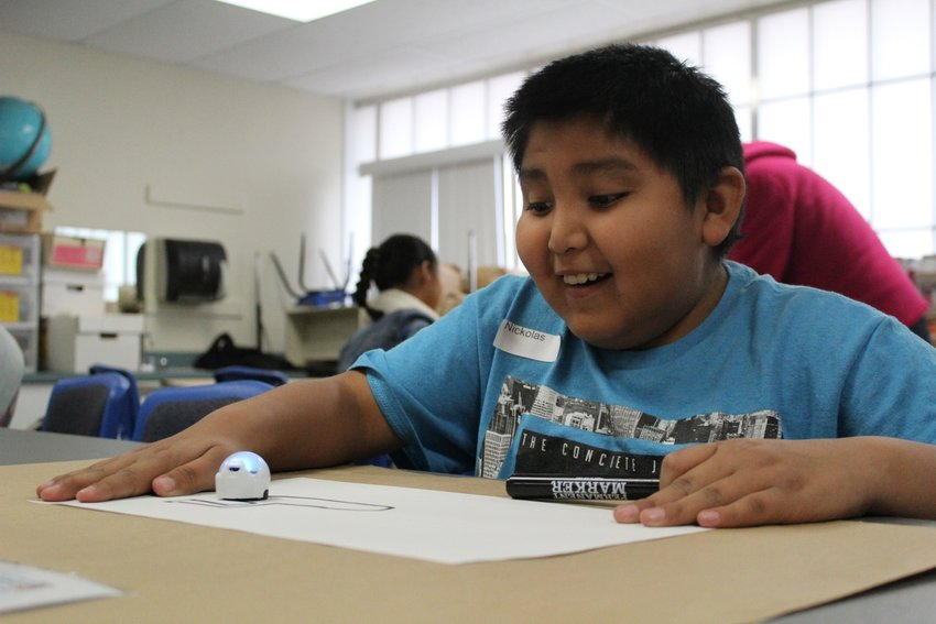 The Science on Wheels programs introduce students to a variety of concepts, such as coding!