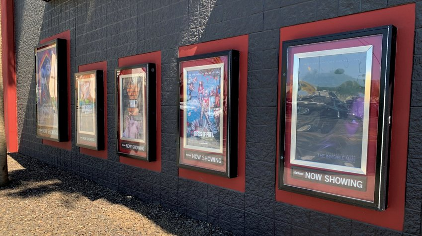 Harkins Chandler Fashion 20, 3159 W. Chandler Blvd., sits idle, displaying posters for films released months ago.