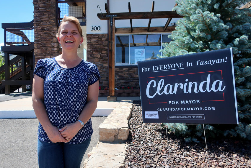 Mayoral candidate Clarinda Vail stands outside the lodge she manages in Tusayan on Tuesday. [Felicia Fonseca/The Associated Press]