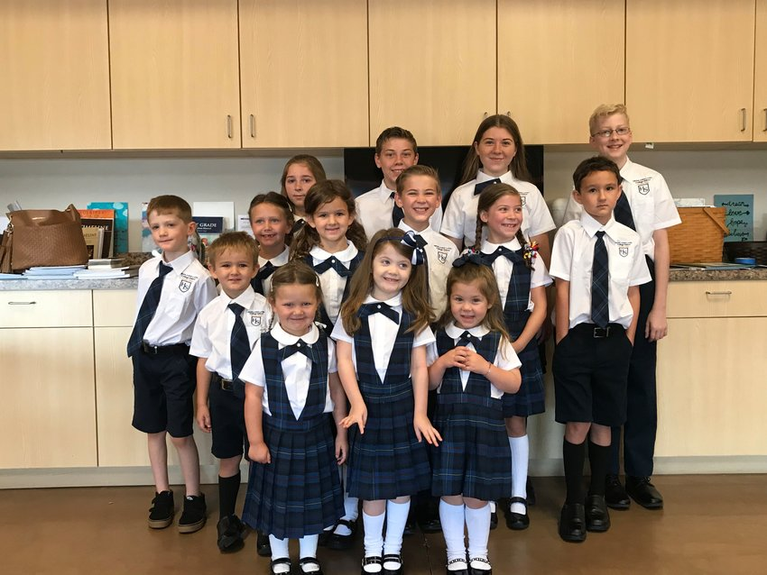 A group photo of students attending the Highlands Latin Cottage School in Paradise Valley. Students wear uniforms during their Mondays gatherings.