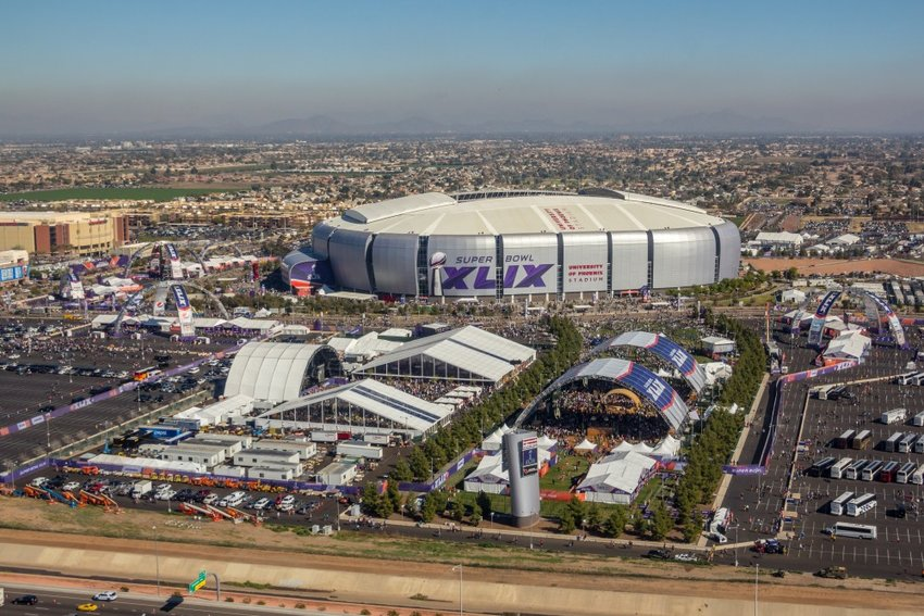 This aerial photo shows University of Phoenix Stadium before the 2015 Super Bowl. The Glendale stadium, now called State Farm Stadium, will host the Super Bowl again in 2023.