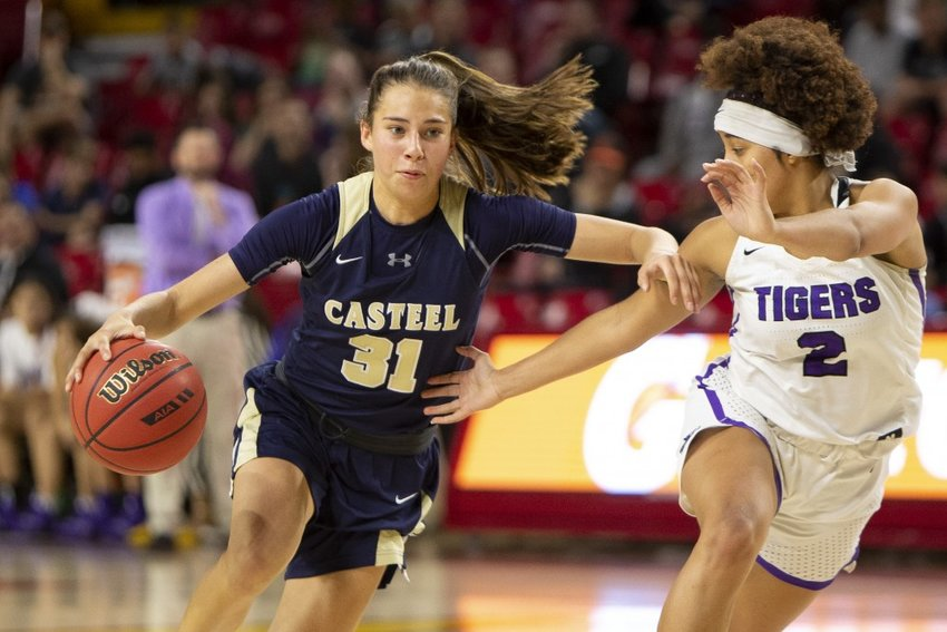 Casteel senior guard Taylor Hall drives to the basket against Millennium junior guard Jasmine Singleton on Feb. 18, 2019 during a 5A girls basketball semifinal at Wells Fargo Arena in Tempe. Singleton signed to play with Nevada-Las Vegas in November.