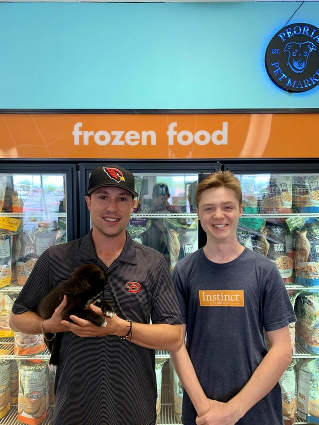 Owner Chris Stewart and assistant manager Jacob Bango at the recently opened Peoria's Pet Market.