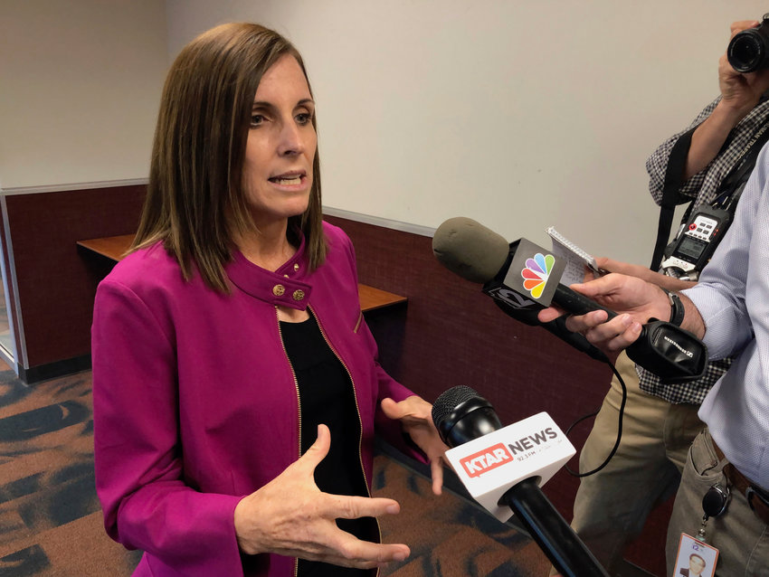 U.S. Sen. Martha McSally, R-Ariz., talks to reporters after an event in Peoria, Ariz., on Monday, Oct. 7, 2019. McSally is declining to say whether she's troubled by President Donald Trump's efforts to get foreign governments to investigate his political rival.