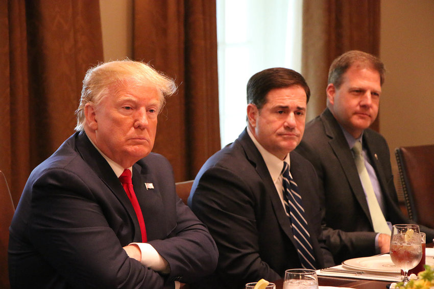 President Donald Trump, Arizona Gov. Doug Ducey and New Hampshire Gov. Chris Sununu, from left, at a White House meeting where Ducey talked about the state's occupational licensing recognition law.