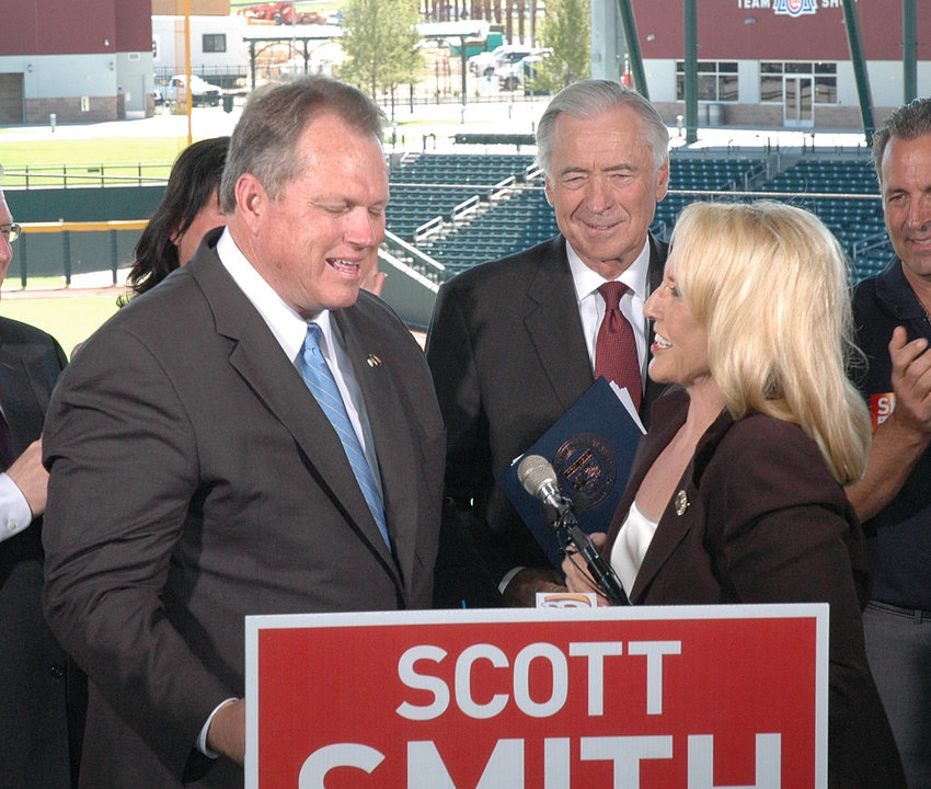 Former Mesa Mayor Scott Smith in 2014 announcing his gubernatorial bid with the assistance of then-Gov. Jan Brewer.