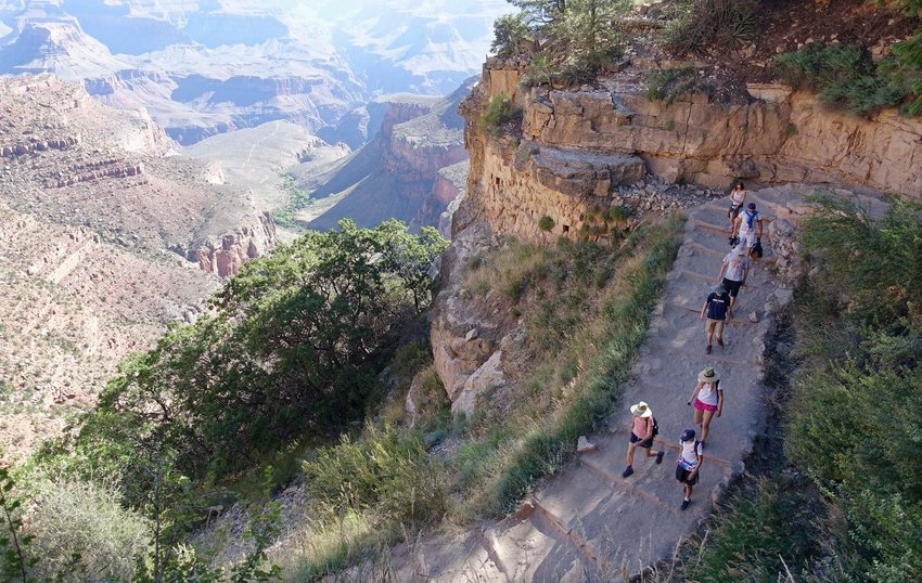 In this July 27, 2015 photo, the busy Bright Angel Trail is crowded with hikers headed down into the Grand Canyon at Grand Canyon National Park, Arizona. The Interior Department is considering recommendations to modernize campgrounds within the National Park Service.