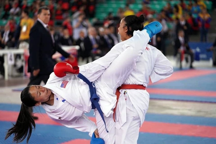 Sabrina Arevalo scores a point during a Tae Kwon Do match.