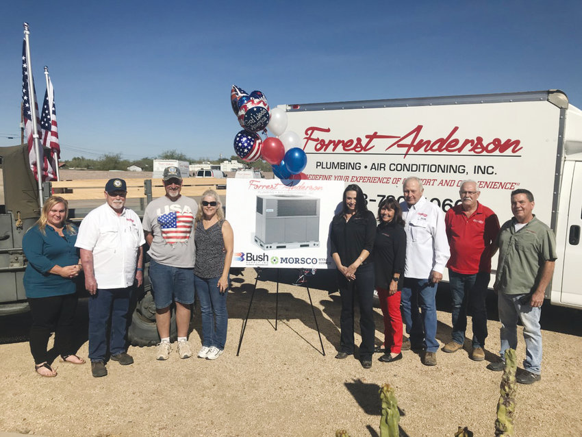 Forrest Anderson Plumbing and AC gives new AC unit to veteran Dan and Brenda Dennison, third and fourth from left. [Submitted photo]